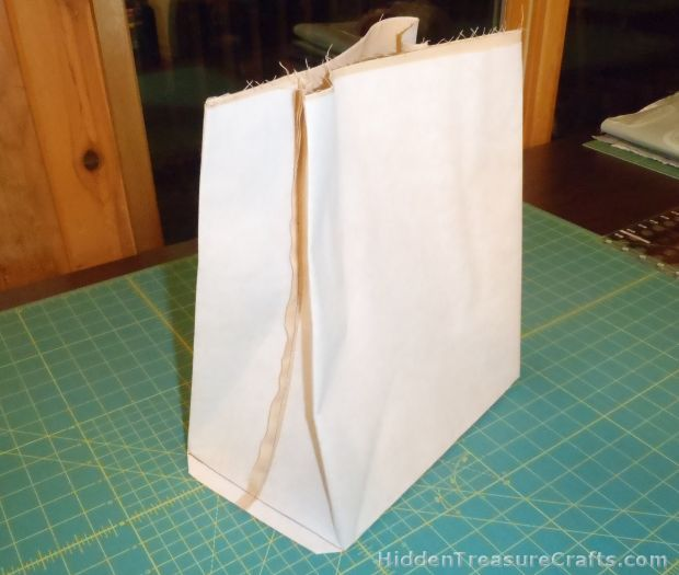 Sew the box bottom on the grocery bag